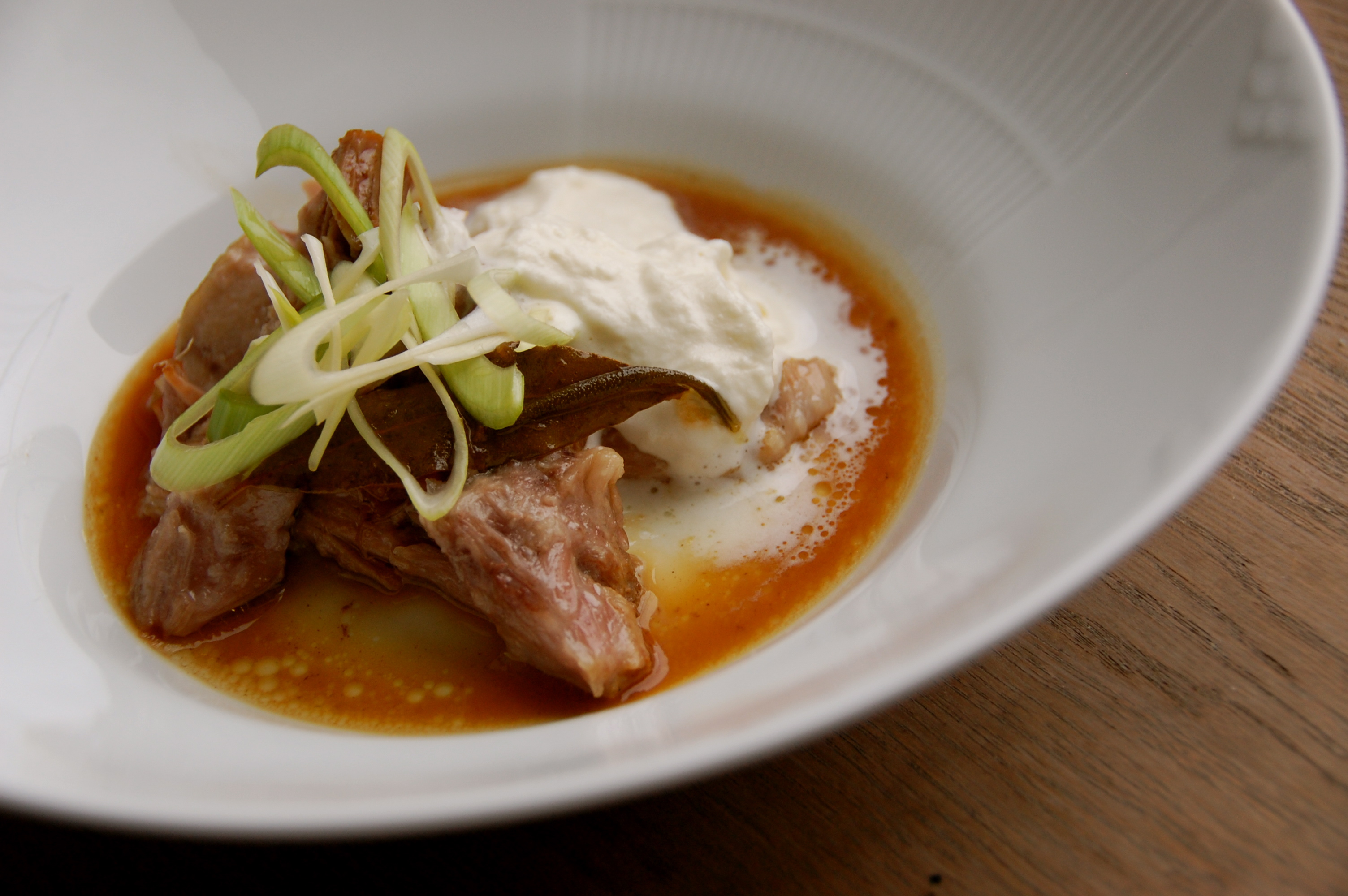 Cider-braised pork with pickled leeks and horseradish